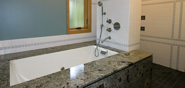 modern_bathrooms_yarrow-graniteundermount-teafortwotub